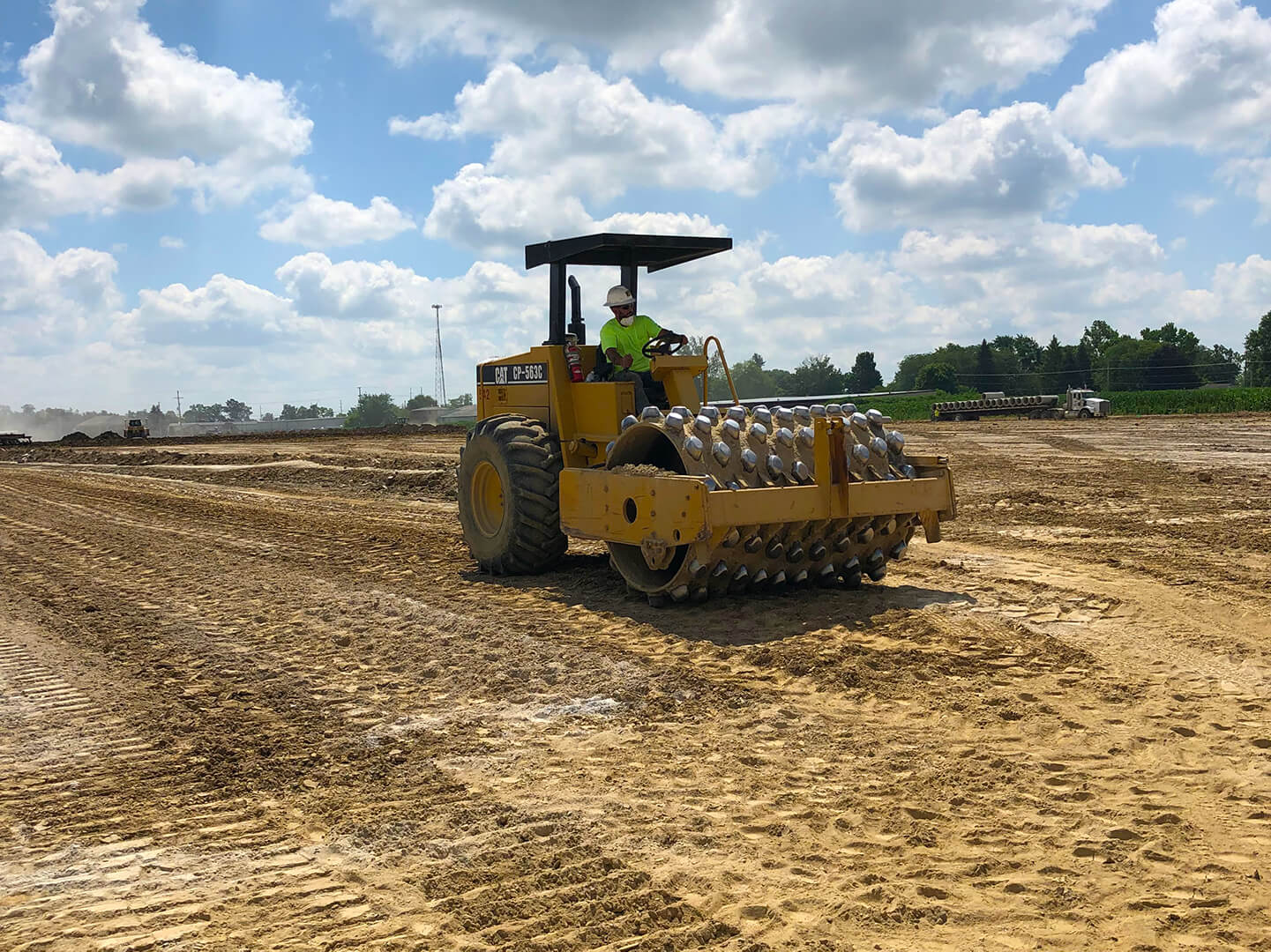 Padfoot roller compacting lime treated soil
